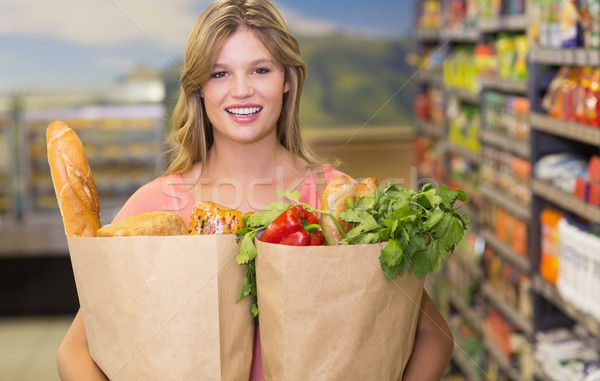 Portrait of pretty blonde woman buying food products  Stock photo © wavebreak_media