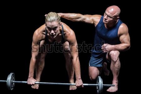 Gespierd man twee crossfit gymnasium Stockfoto © wavebreak_media