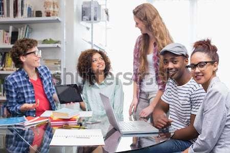Smiling designer using his tablet pc Stock photo © wavebreak_media