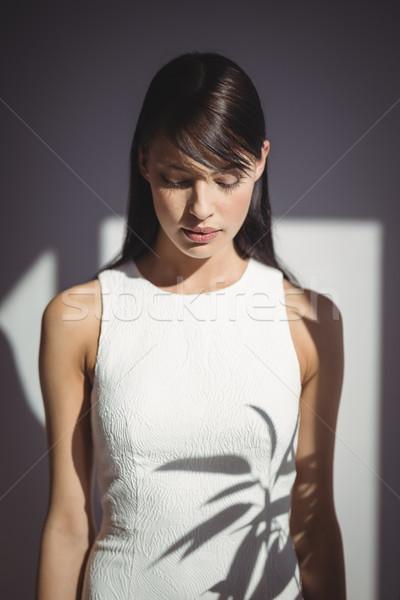женщины исполнительного глядя вниз служба синий Сток-фото © wavebreak_media