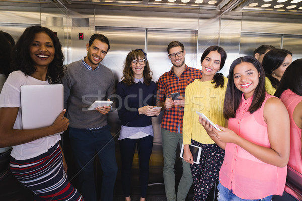 Portrait of business people standing in elevator Stock photo © wavebreak_media