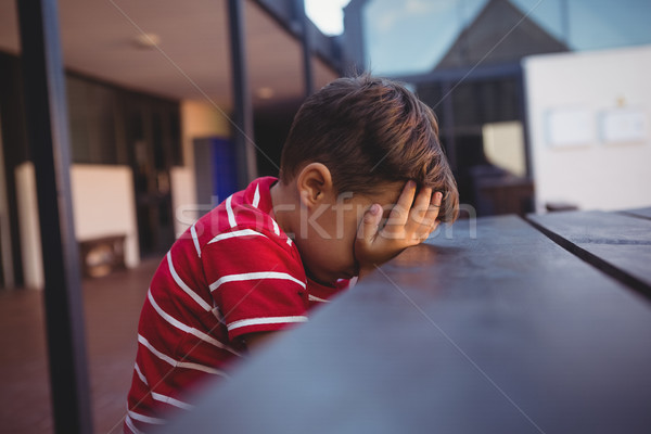 Side view of tired boy leaning on table Stock photo © wavebreak_media