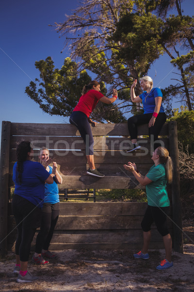 Group of fit women giving high five to each other during obstacle course training Stock photo © wavebreak_media