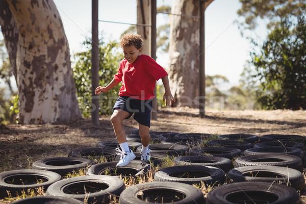Chłopca uruchomiony boot obozu dziecko Zdjęcia stock © wavebreak_media