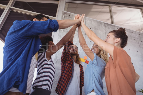Cheerful business people giving high five in creative office Stock photo © wavebreak_media