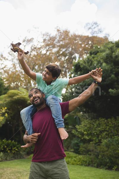 Cheerful father piggybacking son Stock photo © wavebreak_media
