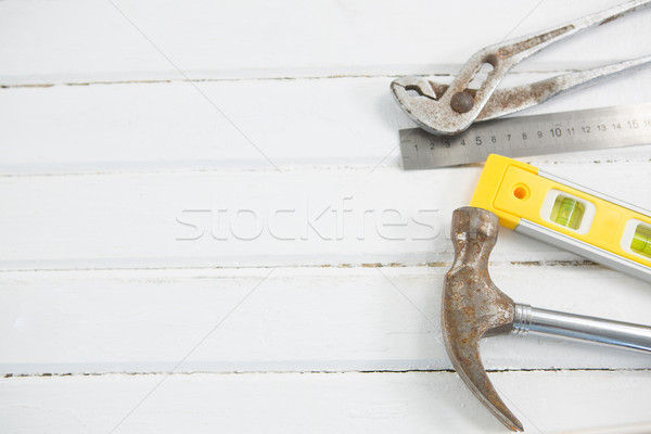 Overhead view of hammer with wrench and ruler on table Stock photo © wavebreak_media