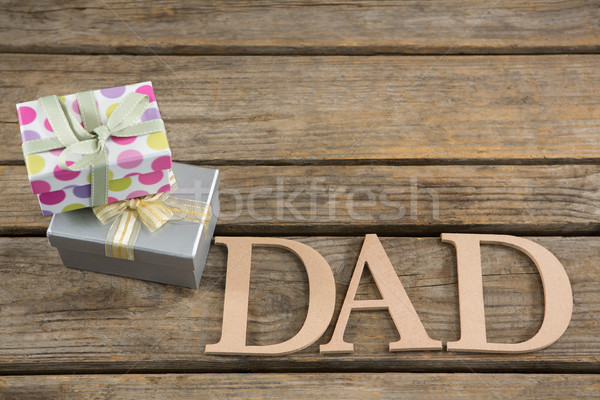 High angle view of dad text by gift boxes on table Stock photo © wavebreak_media