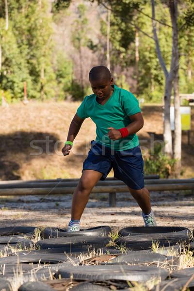 мальчика работает подготовки загрузка лагерь Сток-фото © wavebreak_media