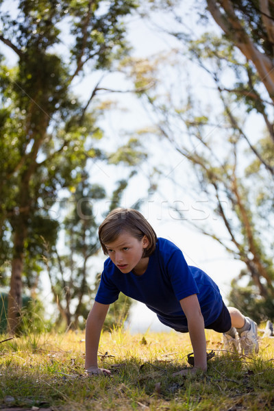 Girl exercising during obstacle course training Stock photo © wavebreak_media