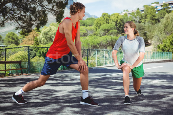 Stock photo: Friends talking while exercising on road