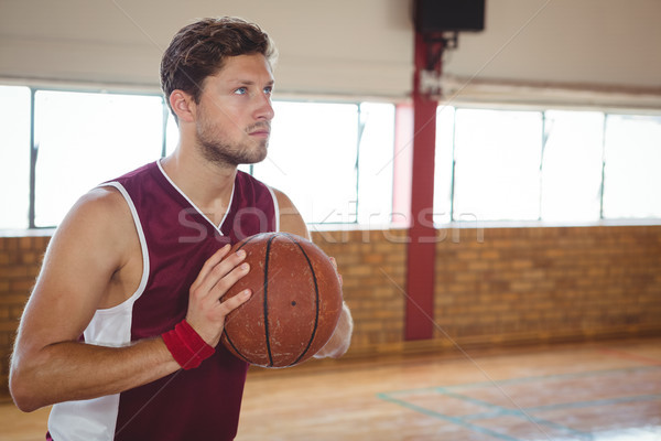Man practicing basketball in court Stock photo © wavebreak_media