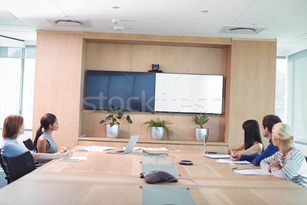 Business people looking at whiteboard during meeting Stock photo © wavebreak_media