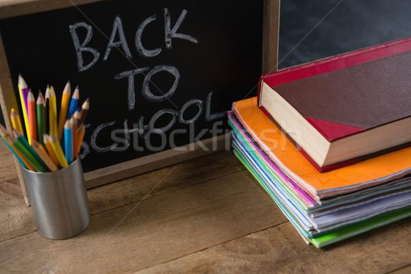 Metin yazılı okul malzemeleri ahşap masa sanat öğrenme Stok fotoğraf © wavebreak_media
