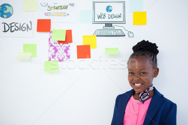 Portrait of cheerful businesswoman standing against sticky notes Stock photo © wavebreak_media