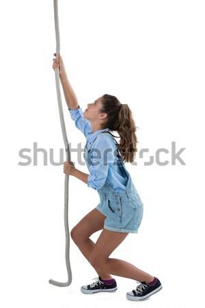 Girl climbing the rope Stock photo © wavebreak_media