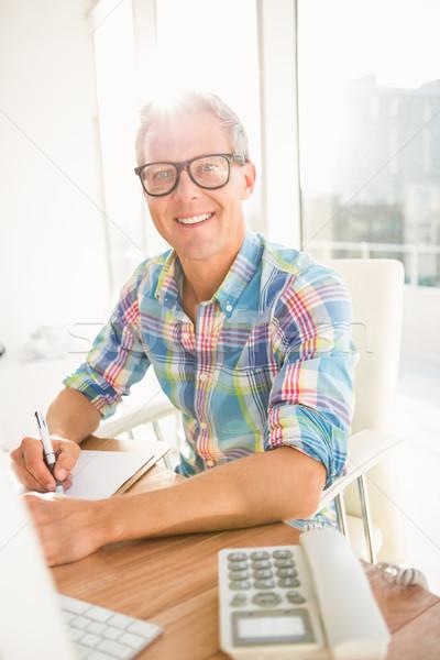Smiling casual designer working at his desk Stock photo © wavebreak_media