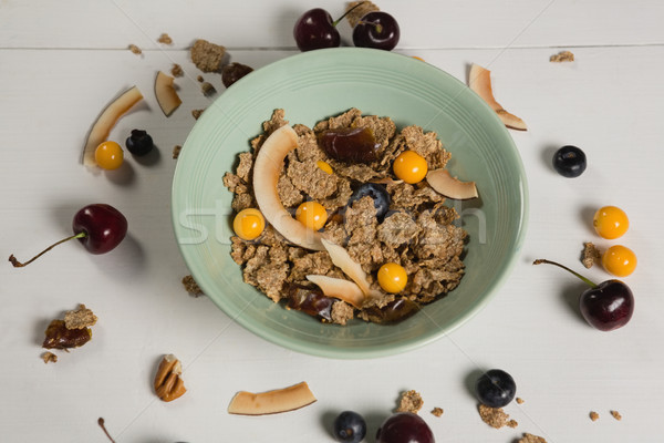 Bowl of wheat flakes with blueberry and golden berry Stock photo © wavebreak_media