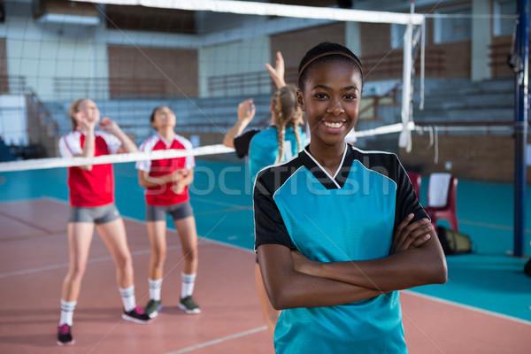 Sorridente feminino voleibol jogador em pé Foto stock © wavebreak_media