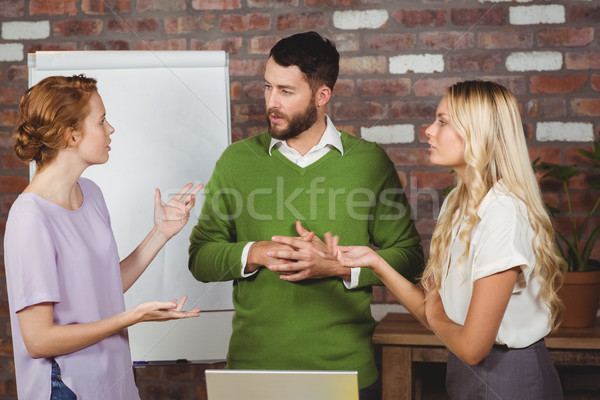 Colleagues talking about work in office Stock photo © wavebreak_media