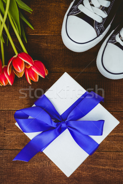 View of sneakers and blue gift Stock photo © wavebreak_media