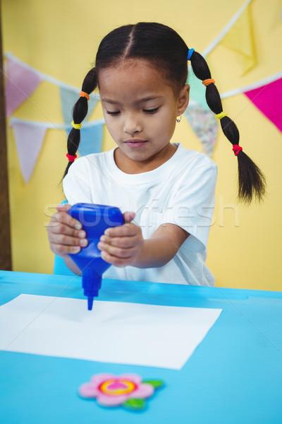 Stock photo: Girl holding a bottle of glue