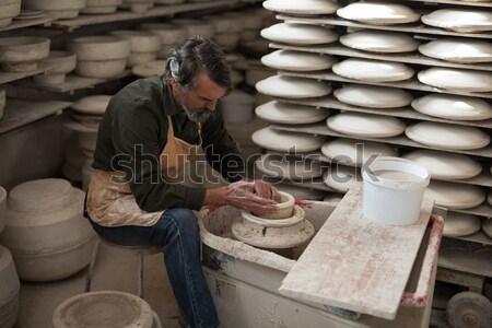 Portrait of female potter molding a clay Stock photo © wavebreak_media