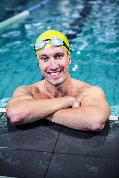Fit swimmer lean on edge of the swimming pool Stock photo © wavebreak_media