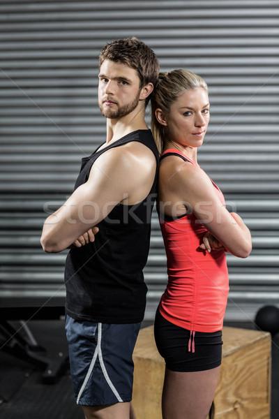 Serious couple standing back to back Stock photo © wavebreak_media