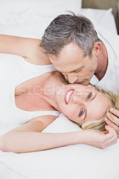 Aranyos pár ölelkezés ágy szoba nő Stock fotó © wavebreak_media