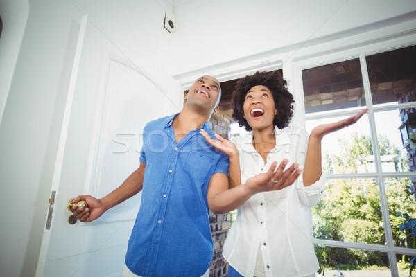 Happy couple entering in their house Stock photo © wavebreak_media