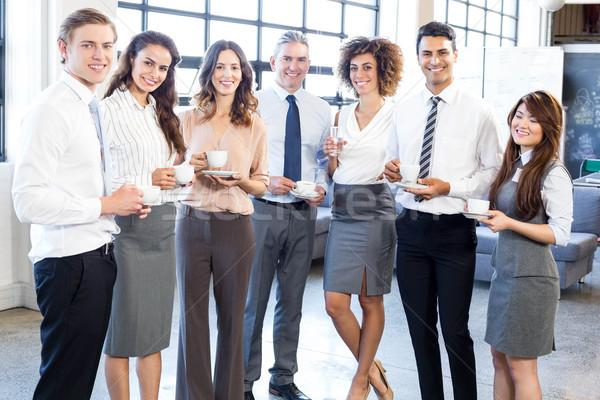 Businesspeople standing together in office Stock photo © wavebreak_media