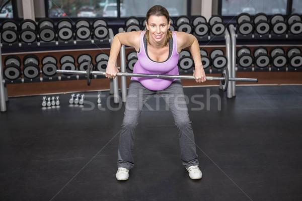 Vastbesloten vrouw barbell gymnasium fitness Stockfoto © wavebreak_media