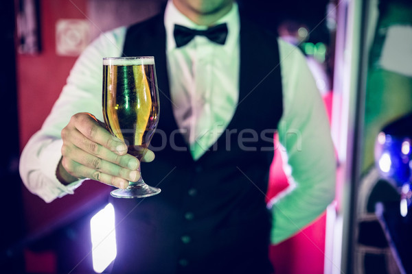 Bartender serving glass of beer Stock photo © wavebreak_media
