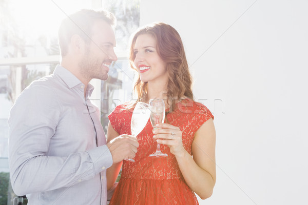 Young couple toasting glasses of champagne Stock photo © wavebreak_media