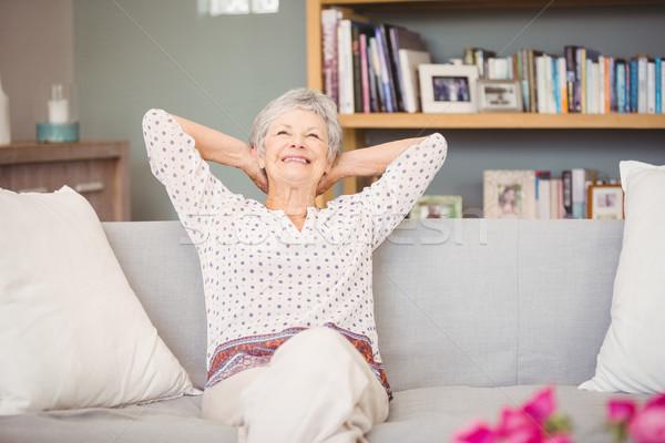 Senior woman relaxing on sofa Stock photo © wavebreak_media