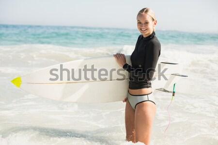 Nő tart szörfdeszka tengerpart napos idő tenger Stock fotó © wavebreak_media