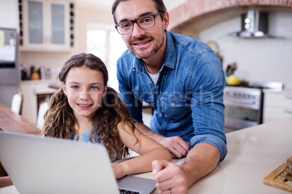 Portrait of father and daughter using laptop in kitchen Stock photo © wavebreak_media