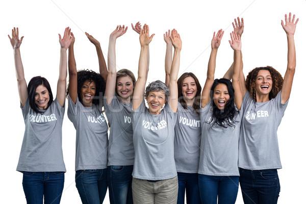 Portrait of happy volunteers standing with hands raised Stock photo © wavebreak_media
