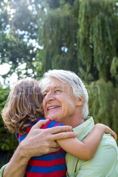Happy grandfather hugging grandson at yard Stock photo © wavebreak_media