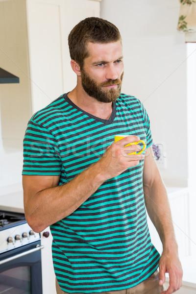 Thoughtful man having a coffee in kitchen Stock photo © wavebreak_media