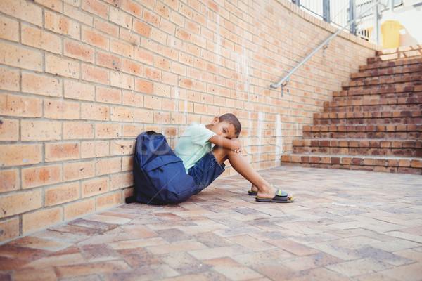 Smutne chłopca głowie posiedzenia szkoły nauki Zdjęcia stock © wavebreak_media