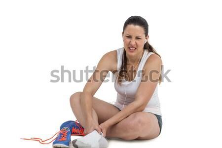 Atleet vrouw voet pijn witte muziek Stockfoto © wavebreak_media