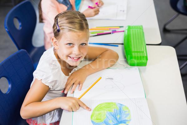 Portrait of schoolgirl studying in classroom Stock photo © wavebreak_media