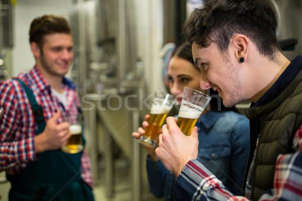 Brewers testing beer at brewery factory Stock photo © wavebreak_media