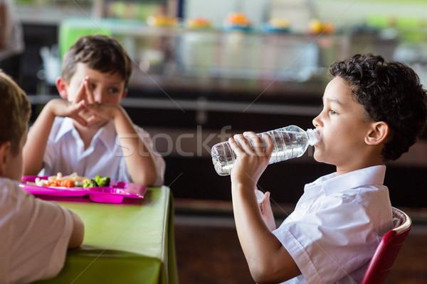школьник питьевая вода бутылку столовая ребенка таблице Сток-фото © wavebreak_media