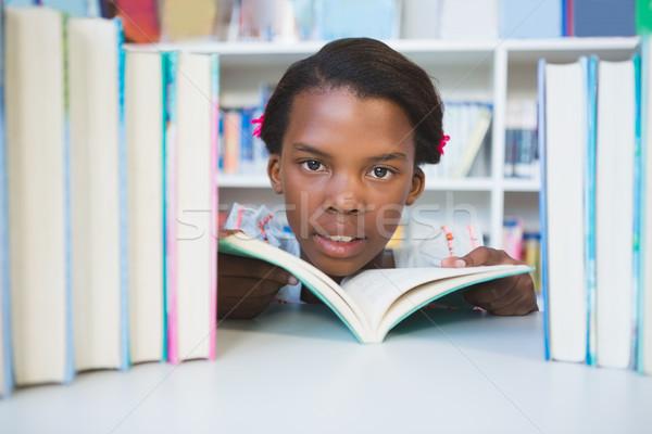Schoolmeisje lezing boek bibliotheek portret school Stockfoto © wavebreak_media