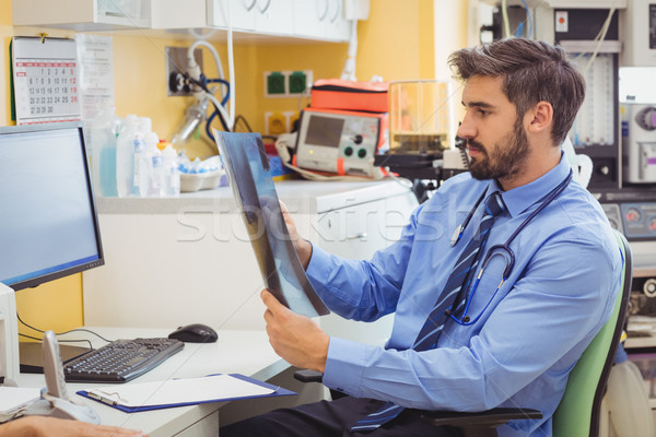 Doctor examining x-ray Stock photo © wavebreak_media