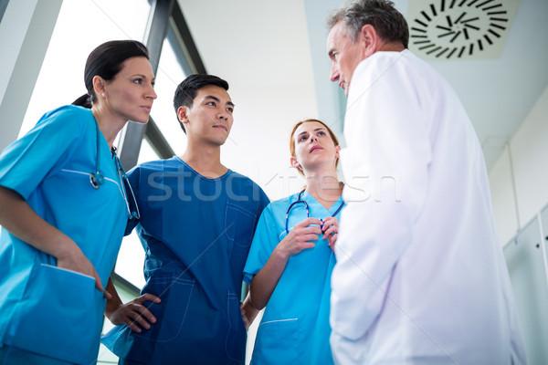 Médecin chirurgiens autre couloir hôpital femme Photo stock © wavebreak_media