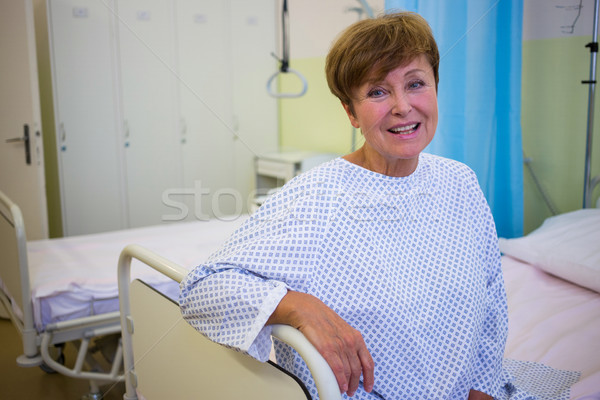 Portrait of smiling senior patient sitting on a bed Stock photo © wavebreak_media